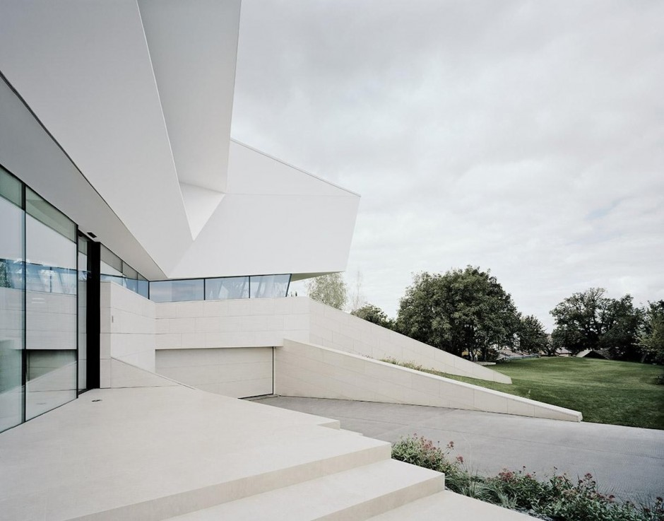 Contemporary white house with a gray driveway
