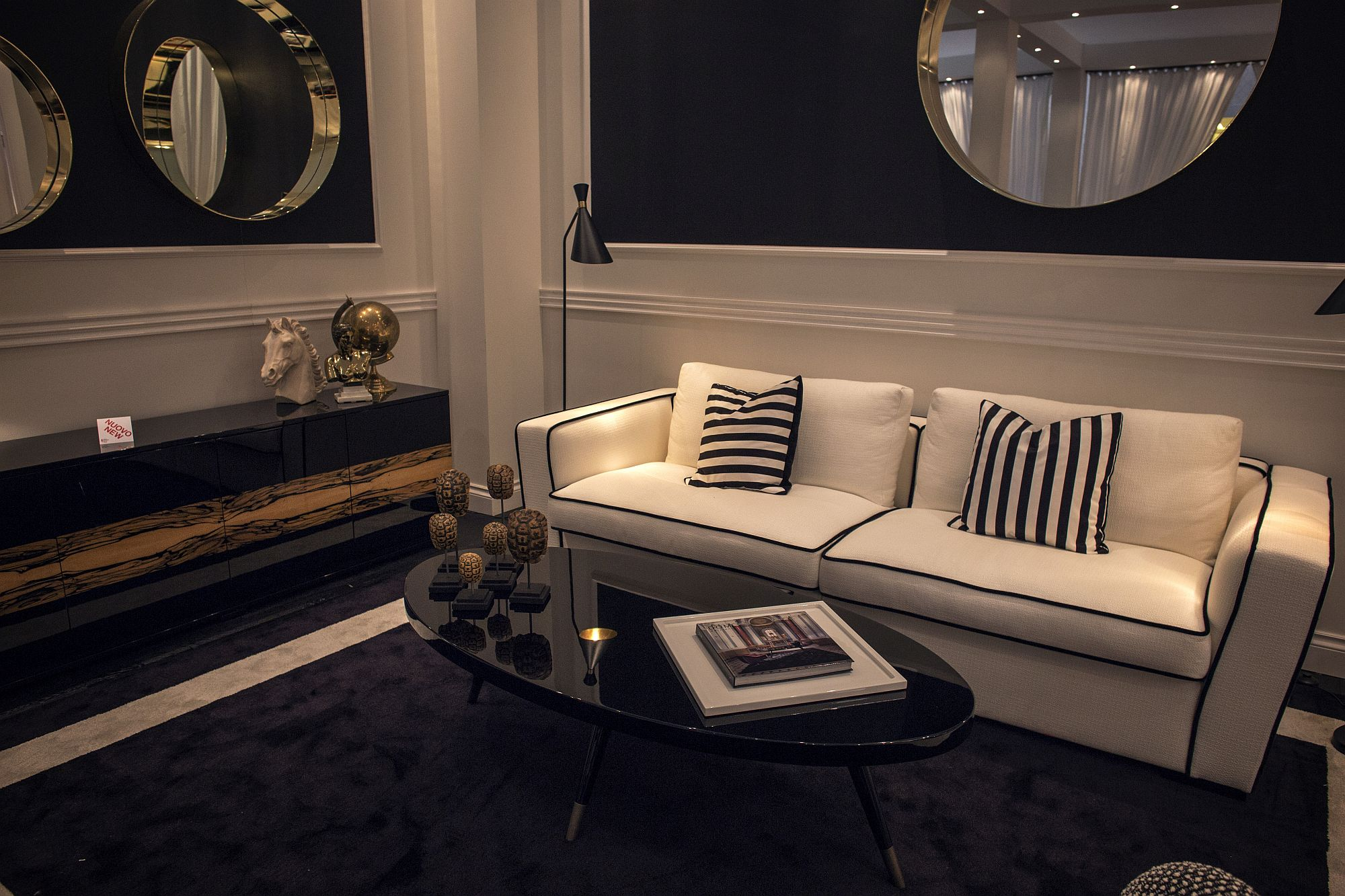 Couch in white next to the black coffee table makes for a dramatic visual