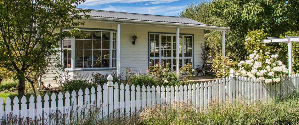 Countryside-home-with-a-white-picket-fence