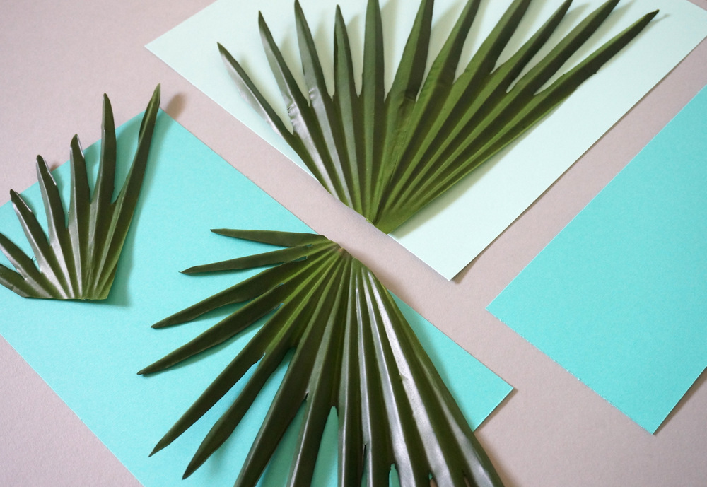 Cut the paper and palm leaves
