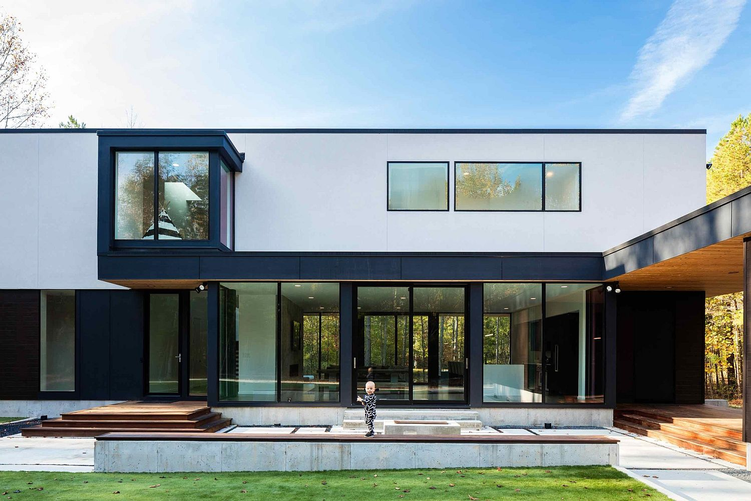 Dark-window-and-door-frames-help-anchor-the-white-contemporary-home