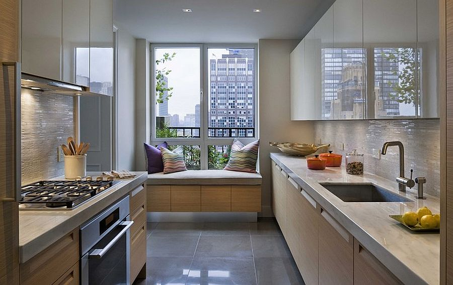 Dashing kitchen of New York City home with window seat