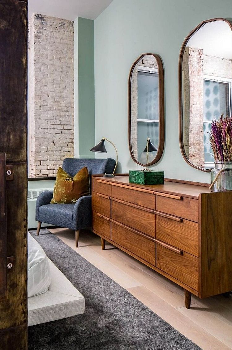 Decorating the bedroom with large mirrors and a cool armchair in the corner