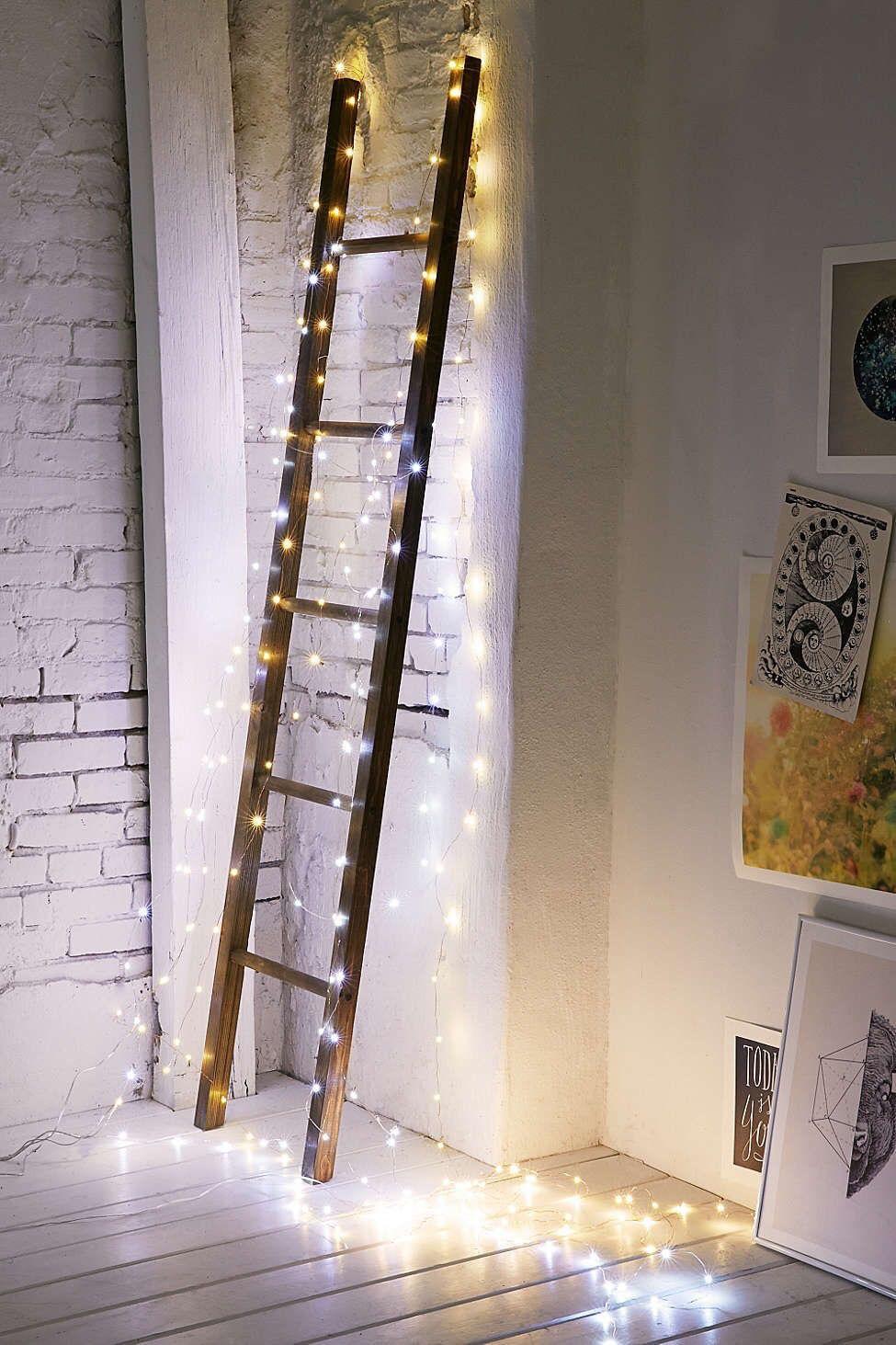 Decorative ladder tangled in string lights