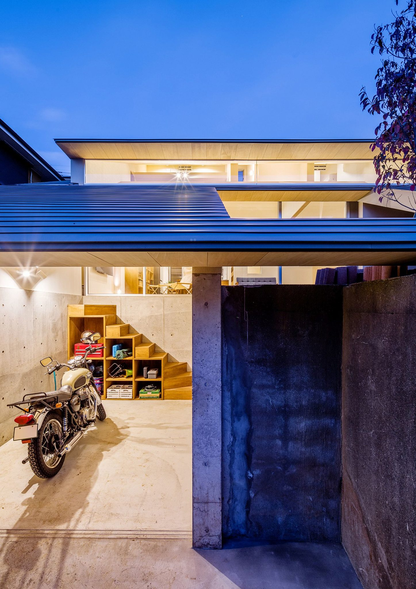 chic japanese house integrates old retaining wall with woodsy