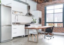 Exposed-brick-wall-and-polished-concrete-floor-for-the-Vancouver-apartment-217x155