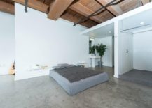 Exposed-wooden-beams-and-ceiling-of-the-modern-bedroom-217x155