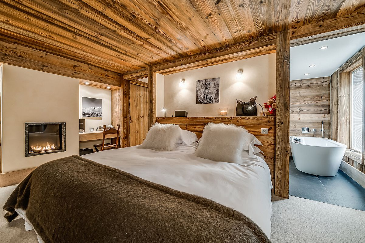 Fireplace-and-workspace-in-the-corner-of-the-chalet-bedroom