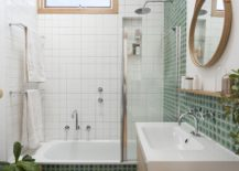 Floating-wooden-vanity-in-the-white-bathroom-with-mirror-that-adds-geo-style-217x155