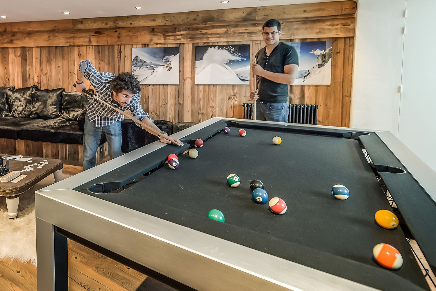 Game room with pool table and darts board