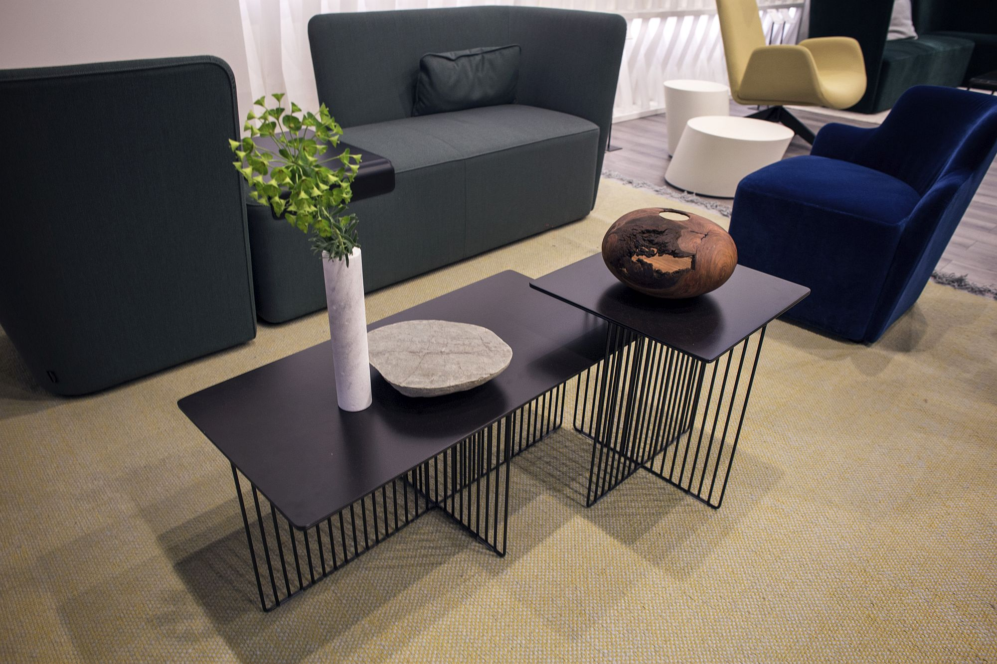 Geo style base of the coffee tables steals the show here