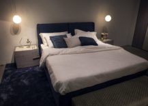 Geometric-contrast-and-metallics-enliven-this-modern-bedroom-217x155