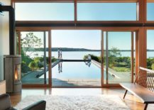 Glass-and-wood-pavilion-with-lap-pool-and-scenic-coastal-view-beyond-217x155