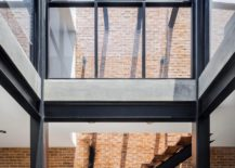Glass-walls-and-metallic-frame-give-the-home-an-industrial-appeal-217x155