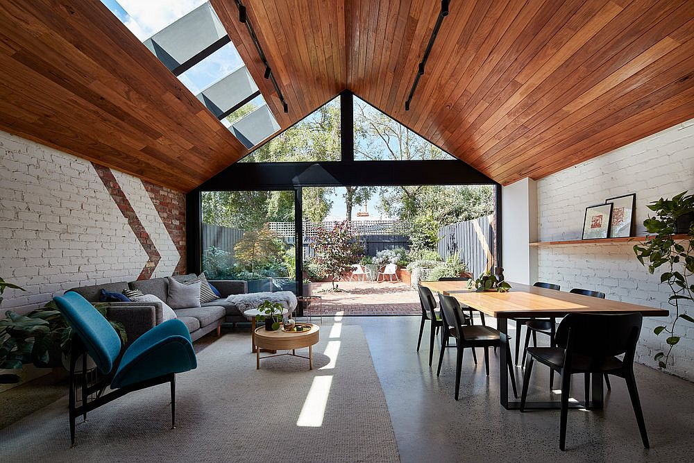 Goregous wood brick and glass extension of the classic Melborne home This Weatherboard Workers Cottage in Melbourne Gets a Stunning New Extension