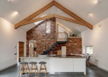 Gorgeous brick wall provides a beuatiful backdrop for contemporary kitchen in white 217x155 Glass and Timber Extension Revamps 18th Century Farmstead in UK