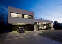 Gray-concrete-driveway-for-a-modern-monochrome-house--217x155