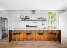 Herringbone-pattern-tiles-create-a-beautiful-backdrop-in-the-kitchen-with-wooden-island-217x155