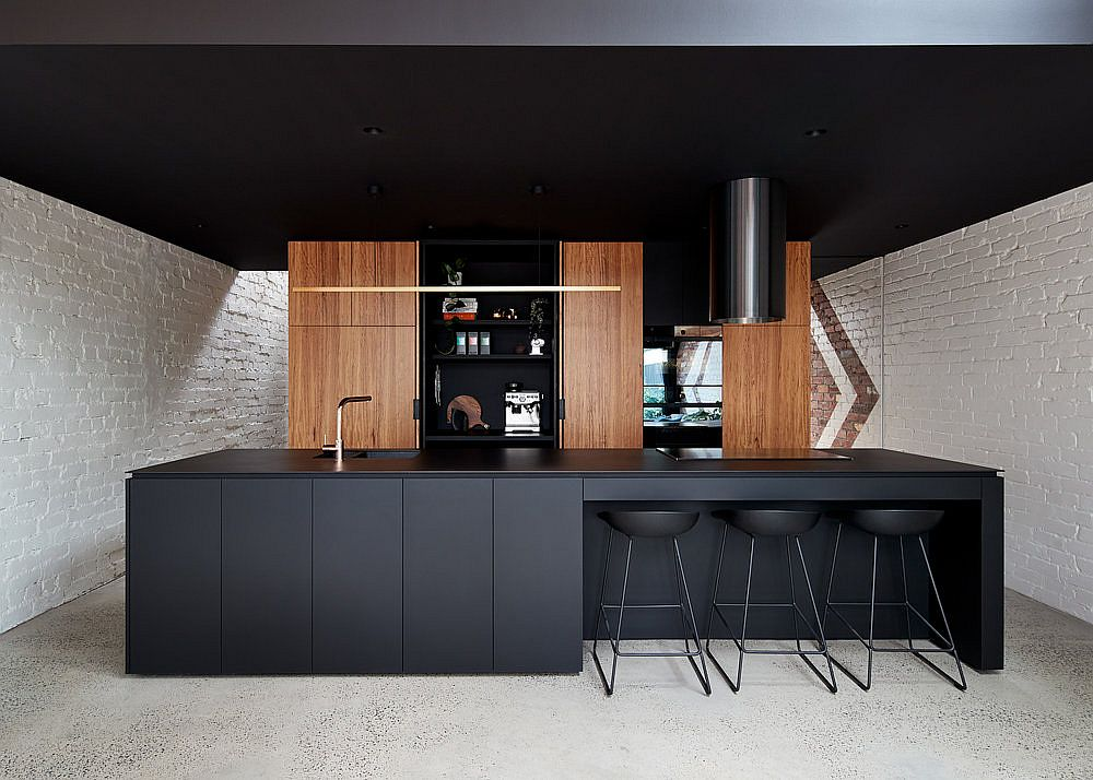 Interior of the cabinets in black add to the dramatic visual