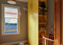 Kids-nursery-and-play-area-with-bright-yellow-shelf-217x155