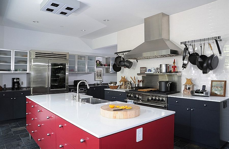 Kitchen in black and white with a polished red island
