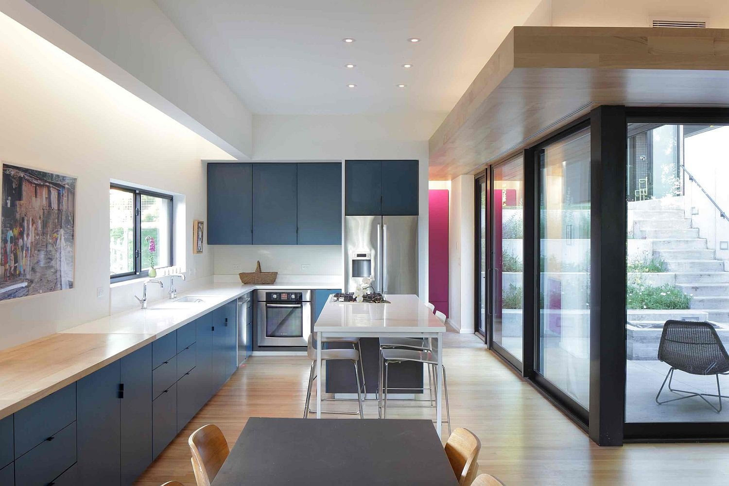 Kitchen in white and blue on the lower level