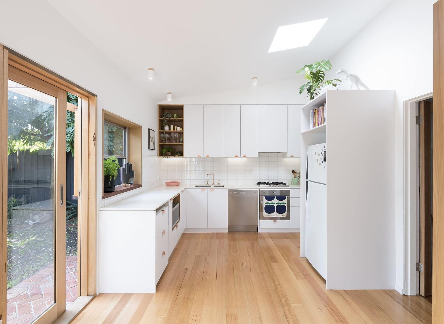 Kitchen in white with skylight