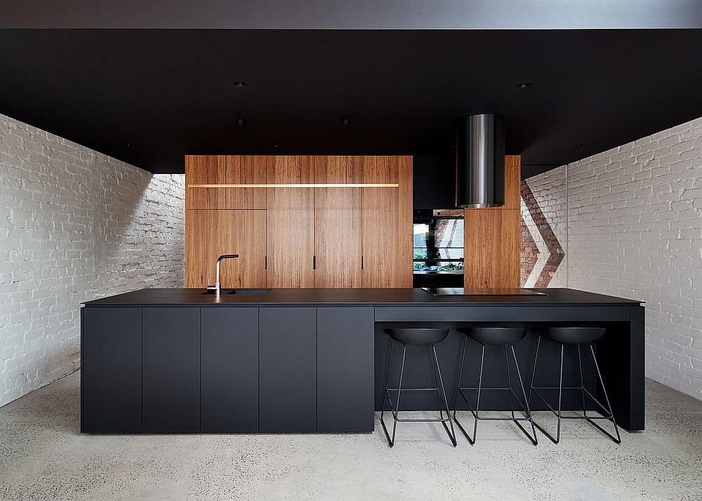 Kitchen with wooden cabinets in the backdrop