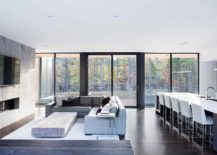 Large-glass-doors-and-windows-connect-the-minimal-interior-with-view-outside-217x155