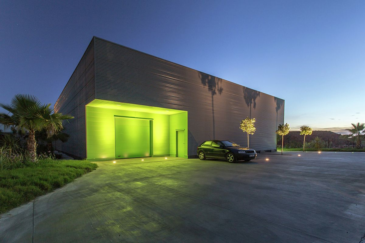 Lighting highlights the green entrance of the office