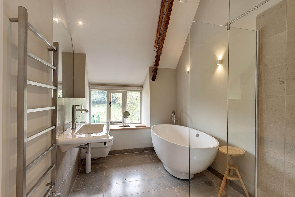Glass and timber extension revamps 18th century farmstead for Slanted ceiling bathroom