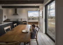 Modern-dining-room-and-kitchen-of-the-farmhouse-with-framed-views-217x155