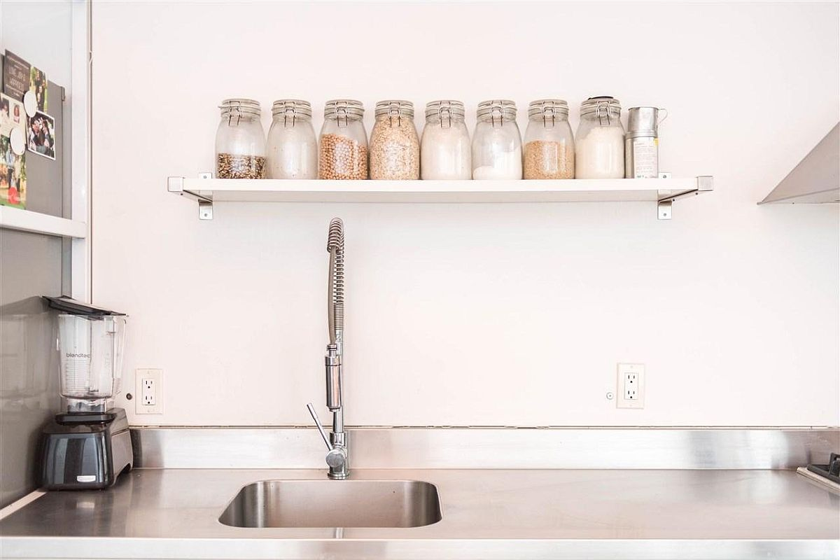 Open kitchen shelf with mason jars