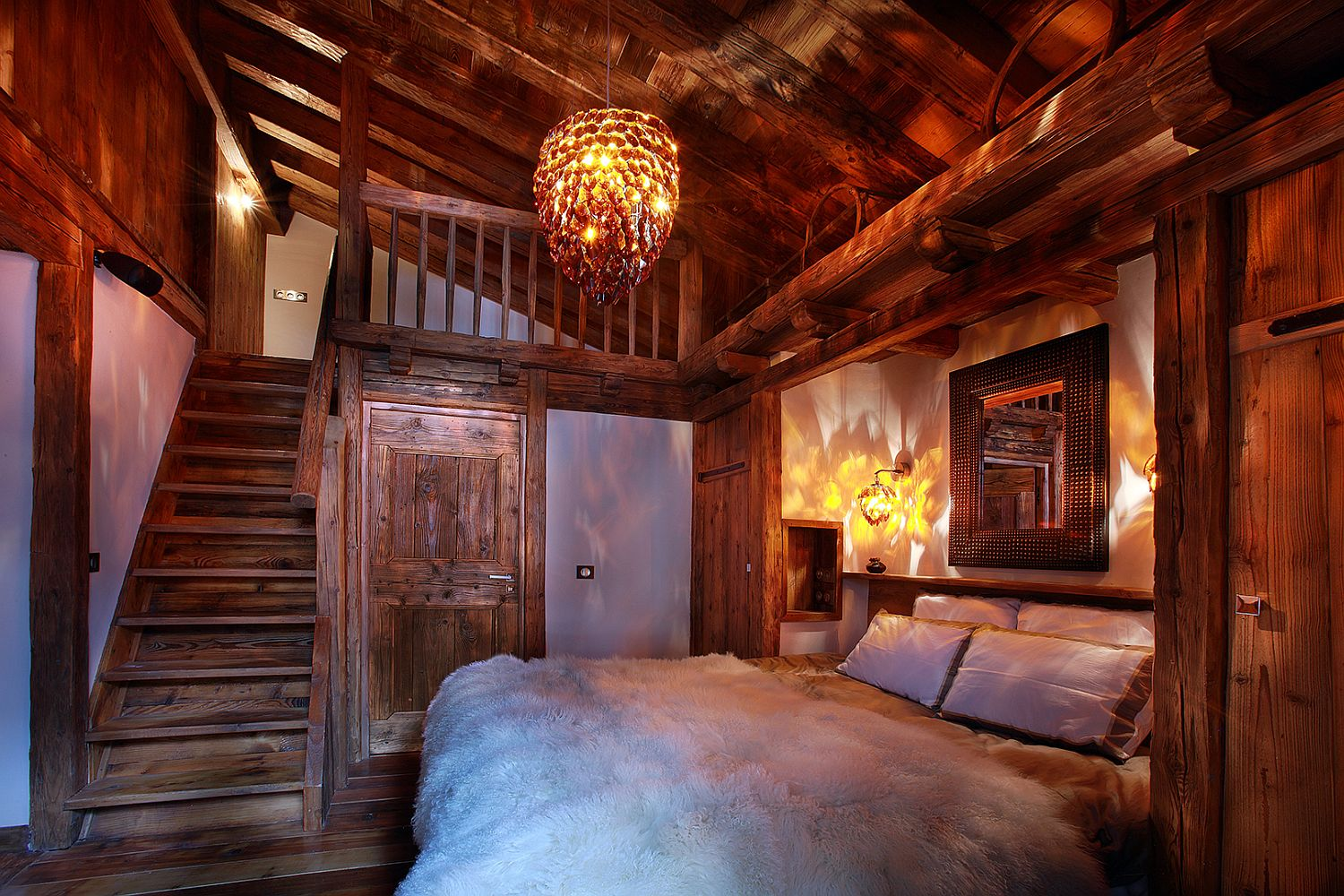 Plush textures add to the inviting charm of the chalet bedroom