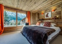 Pops-of-orange-brought-in-by-drapes-and-sconce-lights-into-the-woodsy-bedroom-217x155