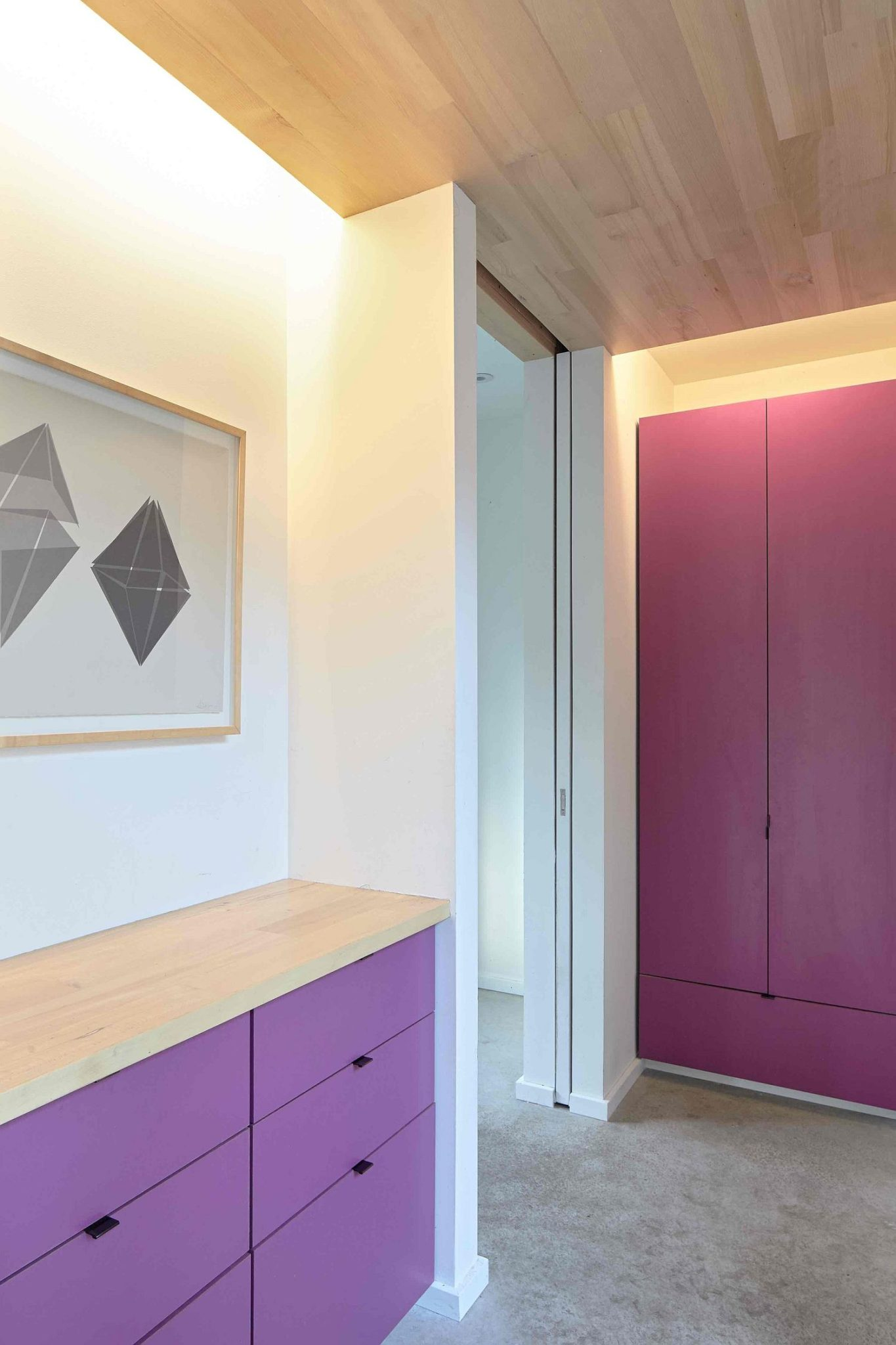 Purple brings color and brightness to the neutral interior