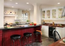 Red-island-energizes-traditional-kitchen-in-white-217x155