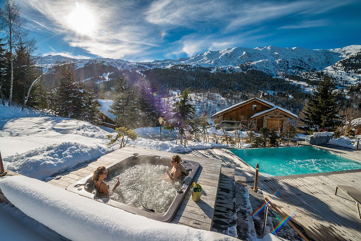 Relaxing-outdoor-heated-infinity-pool-and-spa-at-one-of-Frances-best-luxury-chalet
