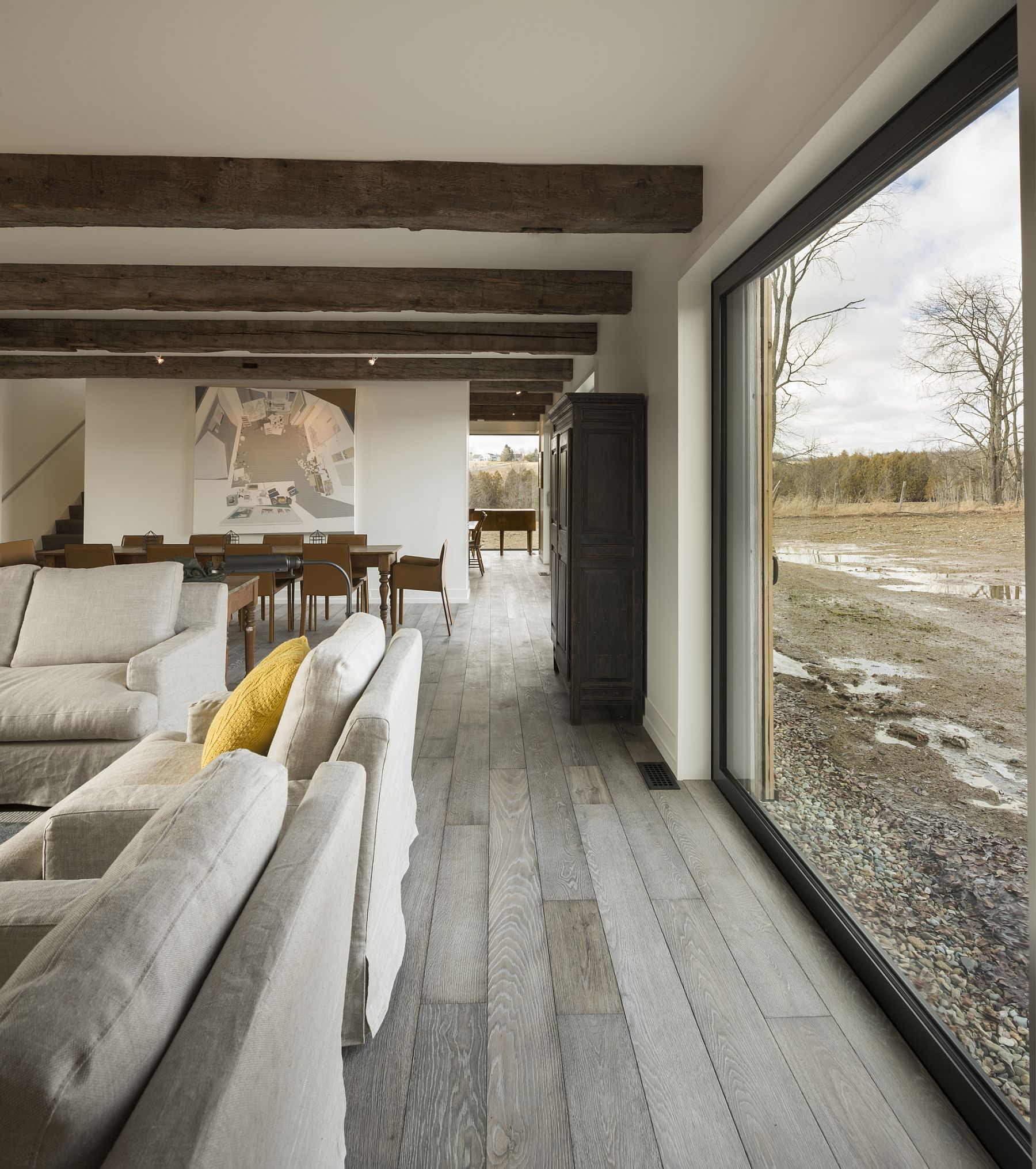 Rustic finishes are coupled with modern decor inside the North Hatley farmhouse