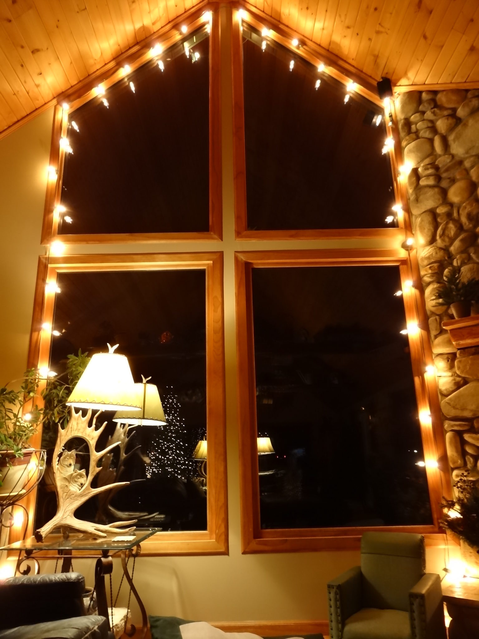 Rustic window decorated with string lights