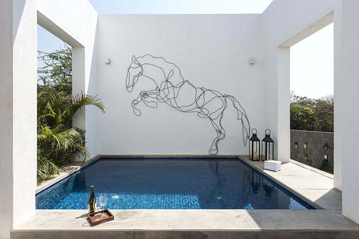 Sculptural figure of a horse on the wall next to the Jacuzzi