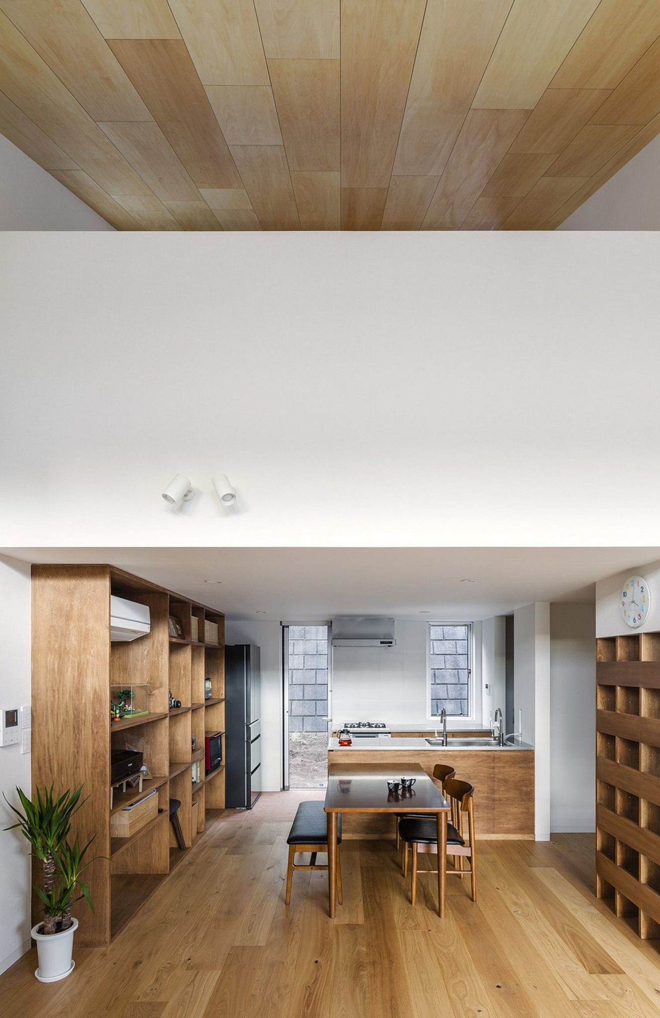 Slanted ceiling and double-height living room of the Japanese home