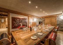 Sliding-barn-door-coupled-with-brilliant-art-work-for-the-chalet-dining-room-217x155