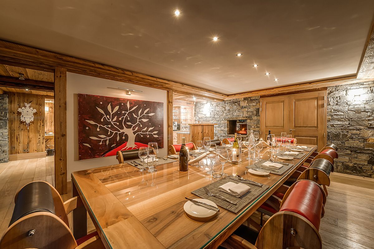 Sliding-barn-door-coupled-with-brilliant-art-work-for-the-chalet-dining-room