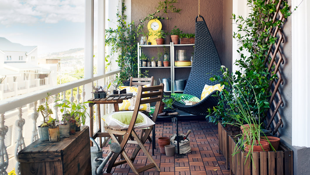 Small balcony with plants completely integrated in the space