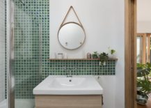 Small-green-tiles-in-the-bathroom-along-with-a-small-vanity-and-stylish-mirror-217x155