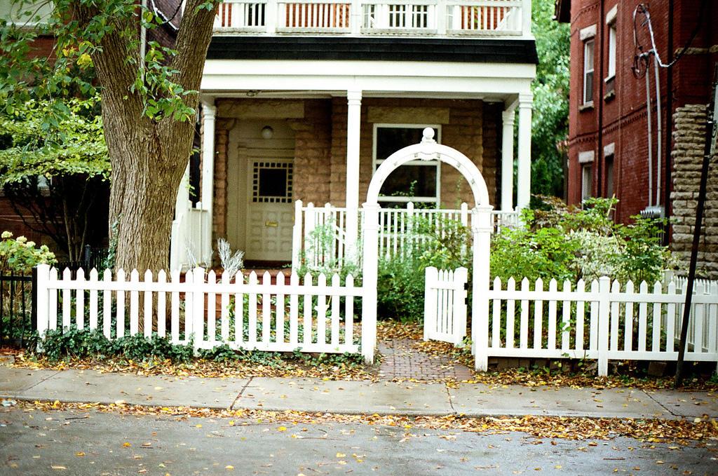 Small-town-house-with-a-white-picket-fence