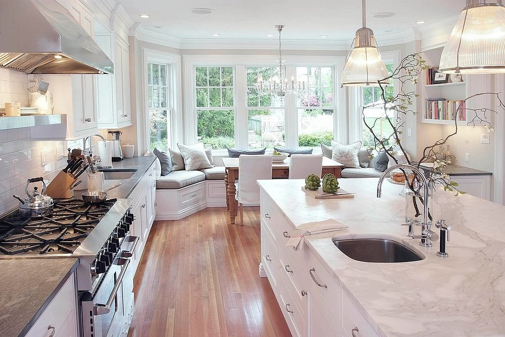 Spacious modern kitchen in white with comfy window seating 10 Delightful Kitchens with Window Seats