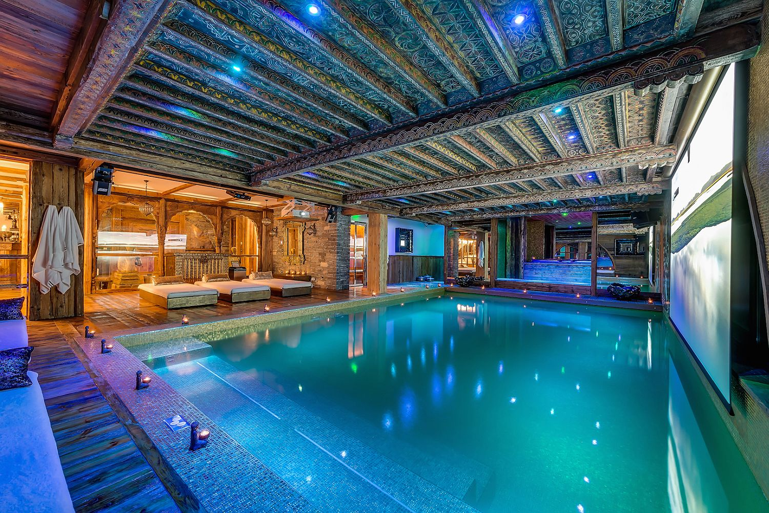 Spacious pool with warm jets is covered in gold leaf