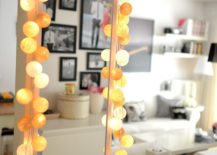 String-lights-draw-attention-to-a-tall-mirror--217x155